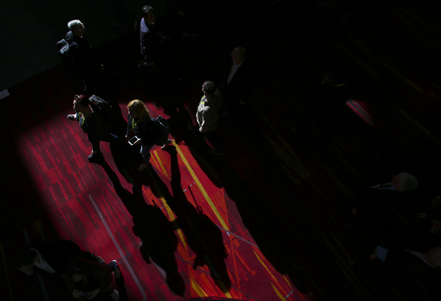 A stream of light shines on attendees during CES at the Las Vegas Convention Center in Las Vegas on Friday, Jan. 6, 2017. (Chase Stevens/Las Vegas Review-Journal) @csstevensphoto