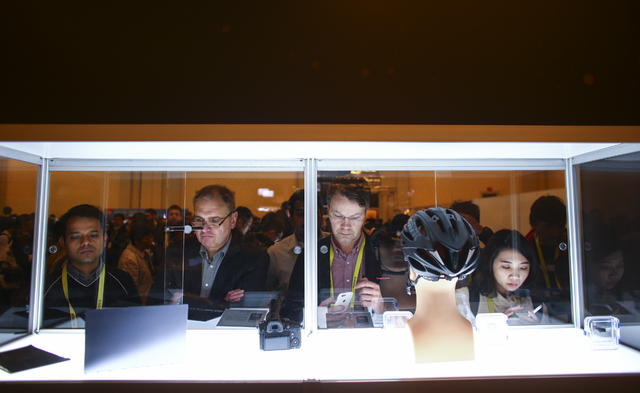 People look at products during the Innovation Awards showcase at CES at the Sands Expo and Convention Center in Las Vegas on Friday, Jan. 6, 2017. (Chase Stevens/Las Vegas Review-Journal) @cssteve ...