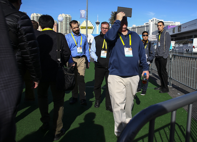 Attendees arrive to CES at the Las Vegas Convention Center in Las Vegas on Friday, Jan. 6, 2017. (Chase Stevens/Las Vegas Review-Journal) @csstevensphoto
