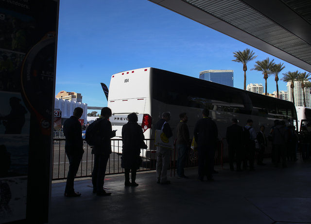 Attendees line up to board a shuttle during CES at the Las Vegas Convention Center in Las Vegas on Friday, Jan. 6, 2017. (Chase Stevens/Las Vegas Review-Journal) @csstevensphoto