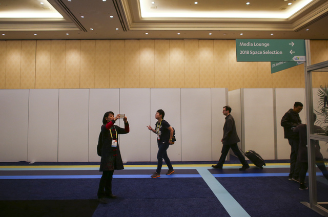 An attendee takes a photo at the Innovation Awards showcase during CES at the Sands Expo and Convention Center in Las Vegas on Friday, Jan. 6, 2017. (Chase Stevens/Las Vegas Review-Journal) @csste ...