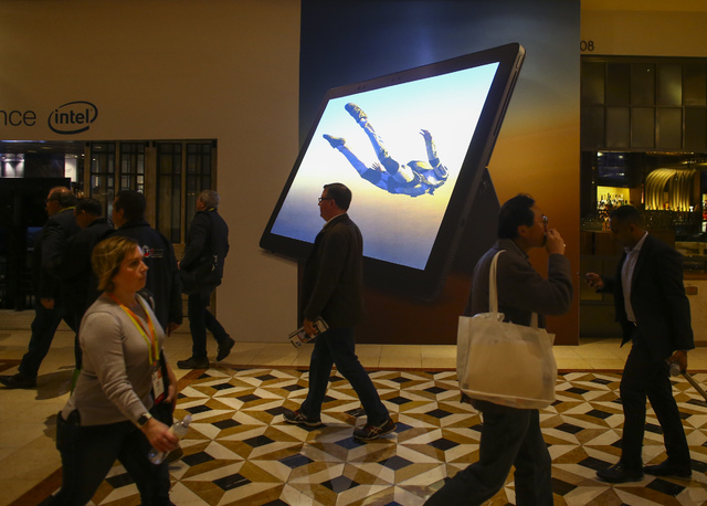 People pass by an Intel advertisement at the Venetian hotel-casino in Las Vegas on Friday, Jan. 6, 2017. (Chase Stevens/Las Vegas Review-Journal) @csstevensphoto