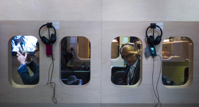 Attendees try out noise-cancelling headphones at the Sony booth during CES at the Las Vegas Convention Center in Las Vegas on Friday, Jan. 6, 2017. (Chase Stevens/Las Vegas Review-Journal) @csstev ...
