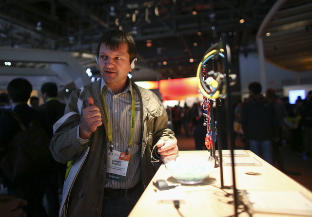 Ludwig Ploetz tries on Walkman wireless headphones during CES at the Las Vegas Convention Center in Las Vegas on Friday, Jan. 6, 2017. (Chase Stevens/Las Vegas Review-Journal) @csstevensphoto