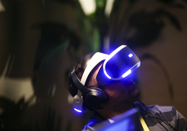 A man uses a Playstation virtual reality headset at the Sony booth during CES at the Las Vegas Convention Center in Las Vegas on Friday, Jan. 6, 2017. (Chase Stevens/Las Vegas Review-Journal) @css ...