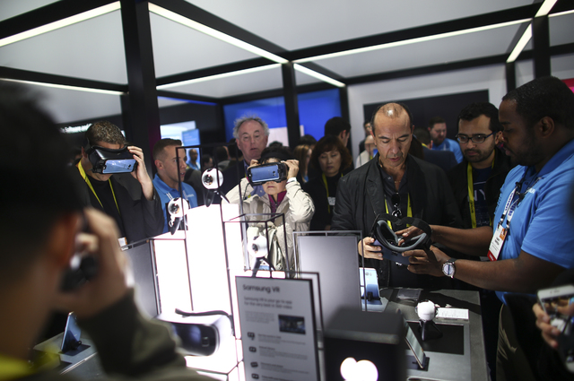 Attendees try on Samsung virtual reality headsets during CES at the Las Vegas Convention Center in Las Vegas on Friday, Jan. 6, 2017. (Chase Stevens/Las Vegas Review-Journal) @csstevensphoto