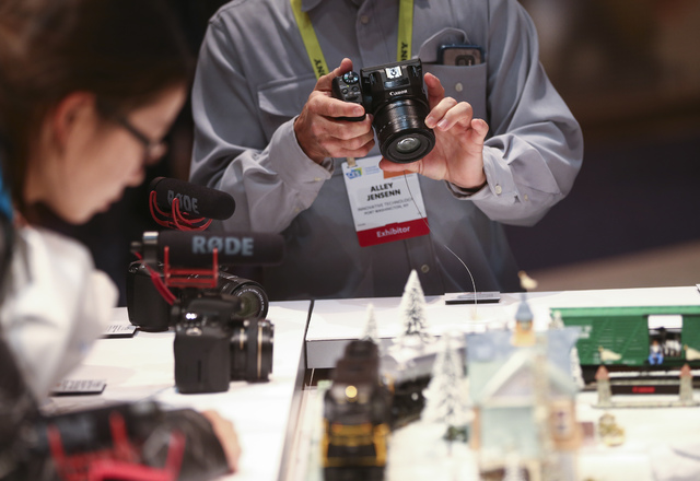 Alley Jensenn tries out a Canon camera during CES at the Las Vegas Convention Center in Las Vegas on Friday, Jan. 6, 2017. (Chase Stevens/Las Vegas Review-Journal) @csstevensphoto