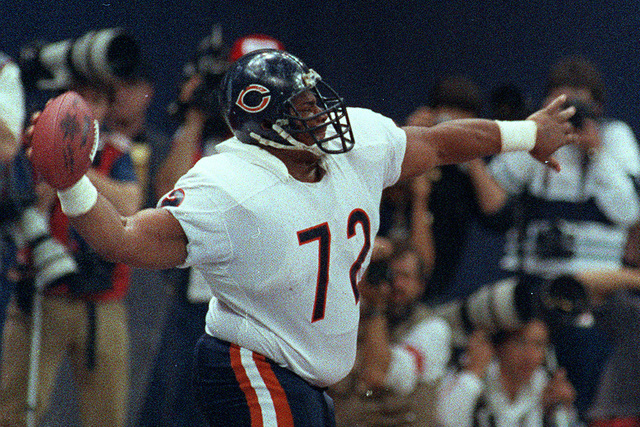 "Chicago Bears' William ""The Refrigerator"" Perry spikes the ball after scoring a touchdown in Super Bowl XX in New Orleans, La., on Jan. 26, 1986.  The Bears won 46-10, scoring th ..."