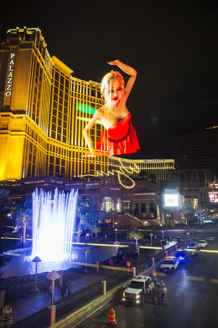 Las Vegas police congregate at Las Vegas Boulevard and Spring Mountain Road outside the Palazzo on Saturday, Dec. 31, 2016. (Benjamin Hager/Las Vegas Review-Journal)