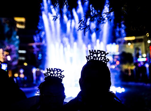 Santos and Maria Hernandez, from San Bernardino, Calif., enjoy the fountain outside the Wynn hotel-casino on the Strip on Saturday, Dec. 31, 2016, on New Year's Eve, in Las Vegas. Benjamin Hager/L ...