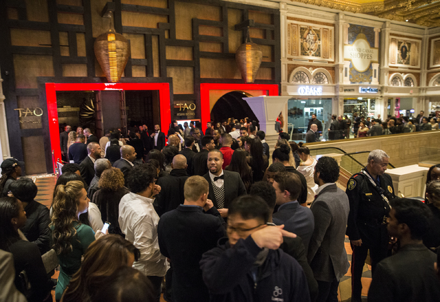 Party goers wait to get in to Tao at Venetian hotel-casino on Saturday, Dec. 31, 2016, on New Year's Eve, in Las Vegas. Benjamin Hager/Las Vegas Review-Journal