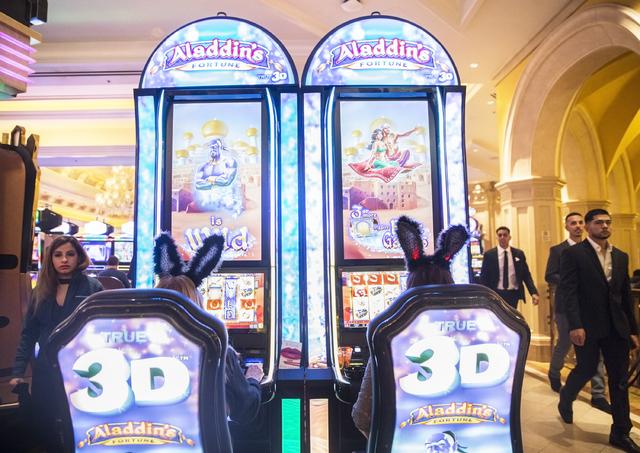 Annie Welder, left, and Paula Johnson gamble at Venetian hotel-casino on Saturday, Dec. 31, 2016, on New Year's Eve, in Las Vegas. Benjamin Hager/Las Vegas Review-Journal