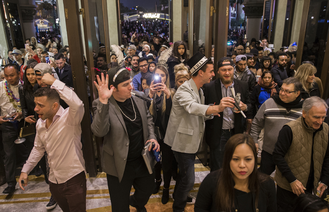 New Year's Eve party goers file back into the Venetian hotel-casino after the fireworks on the Strip on Saturday, Dec. 31, 2016, in Las Vegas. Benjamin Hager/Las Vegas Review-Journal