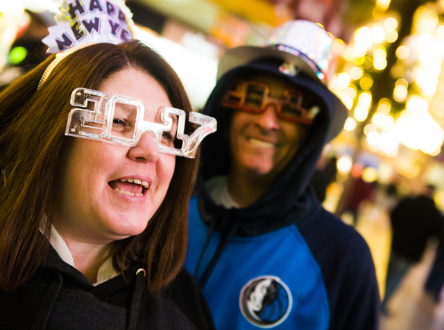Anne-Marie and her husband Orlando listen to live music on the First Street Stage Saturday, Dec. 31, 2016, during America's Party on Fremont Street. Jeff Scheid/Las Vegas Review-Journal Follow @je ...