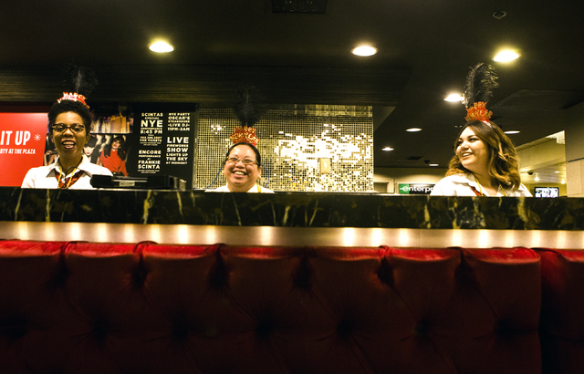 Plaza front desk personnel Malika Lawson, left, Marlene Nato and Jessica Corona share a laugh while waiting to check in guest on Saturday, Dec. 31, 2016. Jeff Scheid/Las Vegas Review-Journal Follo ...