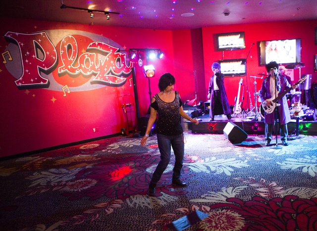 A woman solo dances in front of band at the Plaza hotel/casino on Saturday, Dec. 31, 2016. Jeff Scheid/Las Vegas Review-Journal Follow @jeffscheid