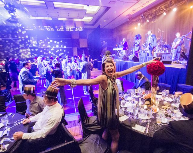 A woman enjoys a moment during a VIP party at the Golden Nugget on Saturday, Dec. 31, 2016. Jeff Scheid/Las Vegas Review-Journal Follow @jeffscheid