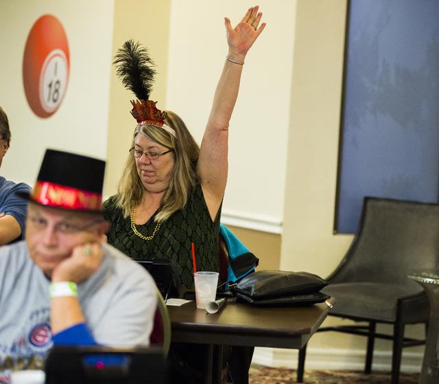 Lynn Richards from Canada, raises her hand after hitting bingo at the Plaza hotel/casino on Saturday, Dec. 31, 2016. Jeff Scheid/Las Vegas Review-Journal Follow @jeffscheid