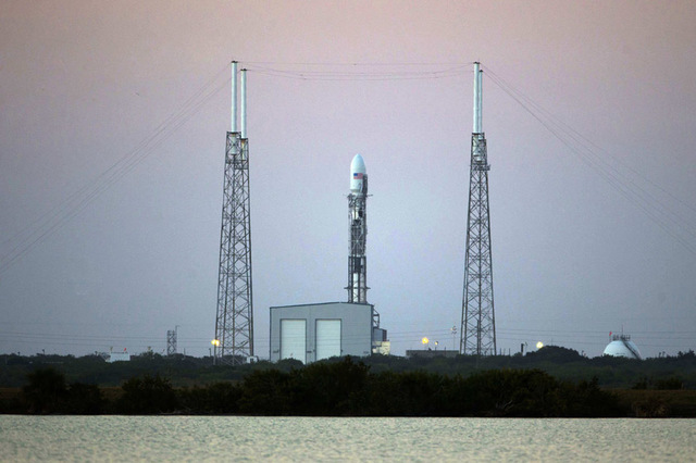 The unmanned Falcon 9 rocket launched by SpaceX carrying NOAA's Deep Space Climate Observatory Satellite sits on launch complex 40 after a scrubbed launch attempt Feb. 8, 2015, at the Cape Canaver ...