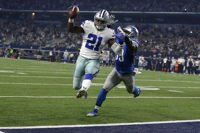 Dallas Cowboys' Ezekiel Elliott (21) leaps into the end zone after getting past Detroit Lions' Tahir Whitehead, rear, for a touchdown in the second half of an NFL football game, Monday, Dec. 26, 2 ...