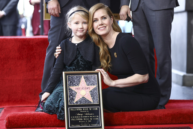 Amy Adams, right, and daughter Aviana Le Gallo attend a ceremony honoring Adams with a star on the Hollywood Walk of Fame on Wednesday, Jan. 11, 2017, in Los Angeles. (Photo by Rich Fury/Invision/AP)