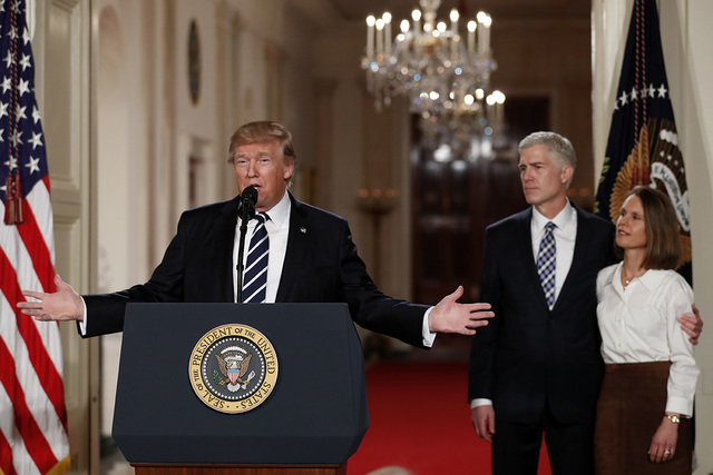 President Donald Trump speaks in the East Room of the White House in Washington, Tuesday, Jan. 31, 2017, to announce Judge Neil Gorsuch as his nominee for the Supreme Court. Gorsuch stands with hi ...