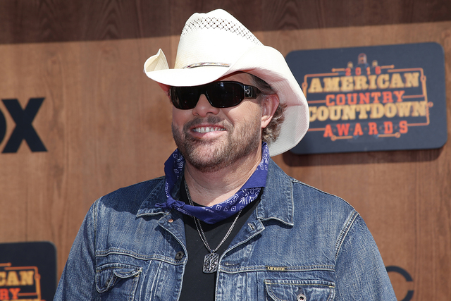 Toby Keith arrives at the American Country Countdown Awards at the Forum on Sunday, May 1, 2016 in Inglewood, Calif. (Photo by Danny Moloshok/Invision/AP)