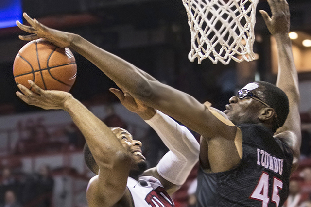 UNLV's Uche Ofoegbu (2) collides with San Diego State's Valentine Izundu (45) during the Rebels home matchup with the Aztecs on Tuesday, Jan. 17, 2017, at the Thomas & Mack Center, in Las Vega ...