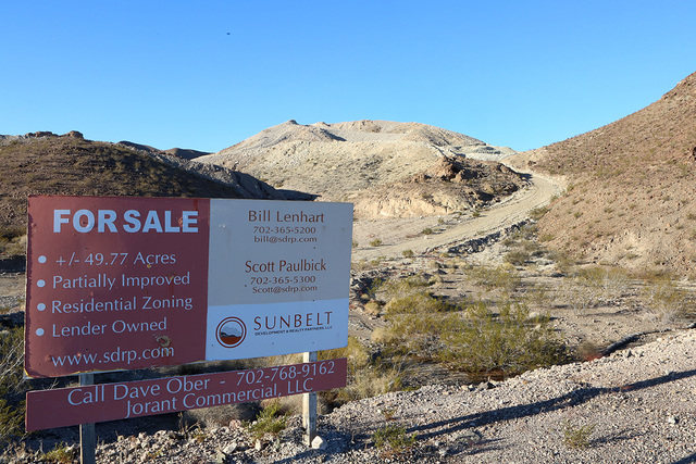 A for sale sign on Lorin Williams Parkway on Thursday, Jan 26, 2017, where Las Vegas Paving., a contractor and big landowner, has acquired almost 50 acres at Lake Las Vegas in Henderson.  (Bizuaye ...
