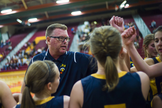 Boulder City girls basketball coach Paul Dosch with his players during a basketball game at Del Sol High School in Las Vegas on Tuesday, Jan. 10, 2017. Dosch, 44, who has been coaching the team fo ...