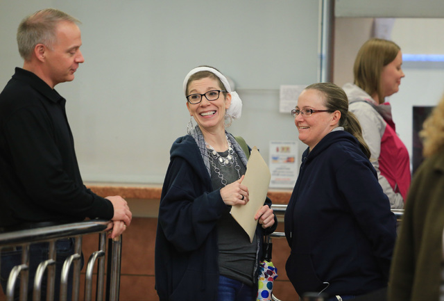 Jennifer Dickerson, 37, center, and Amanda Falzone, 34, right, react to finding out they will receive the 10,000th same sex marriage license at the Clark County Marriage License Bureau in Las Vega ...
