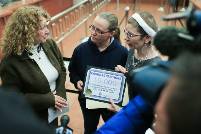 Amanda Falzone, 34, center, and Jennifer Dickerson, 37, right, who were issued the 10,000th same sex marriage license in Clark County, talk to Clark County Clerk Lynn Goya, right, at the Clark Cou ...