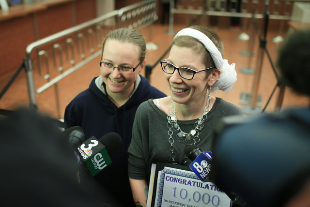 Amanda Falzone, 34, left, and Jennifer Dickerson, 37, right, are interviewed after being issued the 10,000th same sex marriage license in Clark County at the Clark County Marriage License Bureau i ...