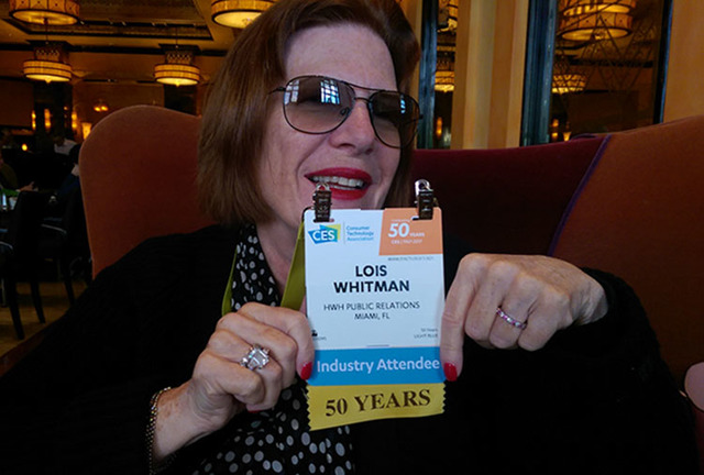 """Lois Whitman, 69, holds up this year's CES badge, which labels her as a 50-year attendee. """"She's an institution, a legend in the PR world,"""" says the CEO of CES, Gary Shapiro. Brooke Wanser/Las V ..."""