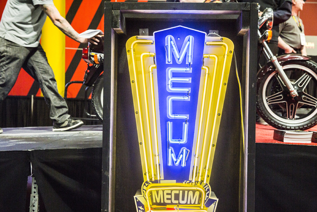 A bike is wheeled onto the stage during the 26th annual Mecum Las Vegas Motorcycle Auction at South Point hotel-casino, in Las Vegas. Over 1,000 antique, vintage and collectible motorcycles are sl ...