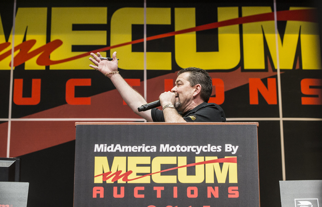 Auctioneer Jimmy Landis takes bids during the 26th annual Mecum Las Vegas Motorcycle Auction at South Point hotel-casino, in Las Vegas. Over 1,000 antique, vintage and collectible motorcycles are  ...
