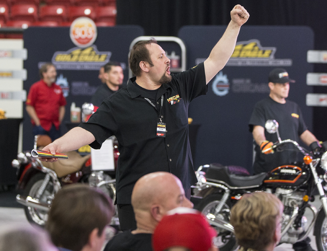 Auctioneer Ricky Rehm calls out a bid from the crowd during the 26th annual Mecum Las Vegas Motorcycle Auction at South Point hotel-casino, in Las Vegas. Over 1,000 antique, vintage and collectibl ...