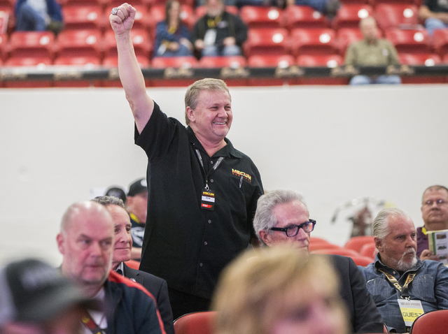 Auctioneer Ben Gunter celebrates a winning bid during the 26th annual Mecum Las Vegas Motorcycle Auction at South Point hotel-casino, in Las Vegas. Over 1,000 antique, vintage and collectible moto ...