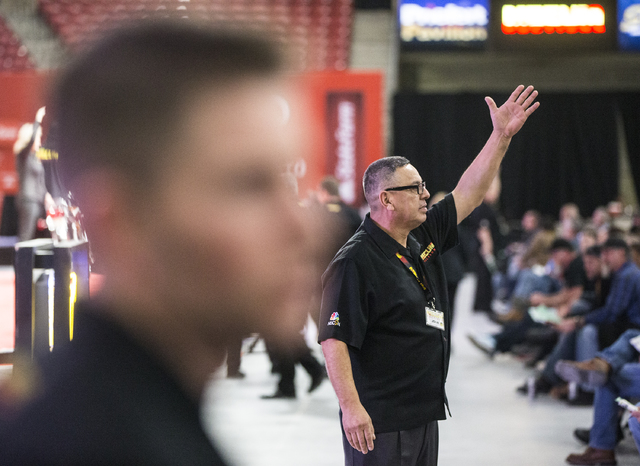 Auctioneer John Miranda acknowledges a bid during the 26th annual Mecum Las Vegas Motorcycle Auction at South Point hotel-casino, in Las Vegas. Over 1,000 antique, vintage and collectible motorcyc ...