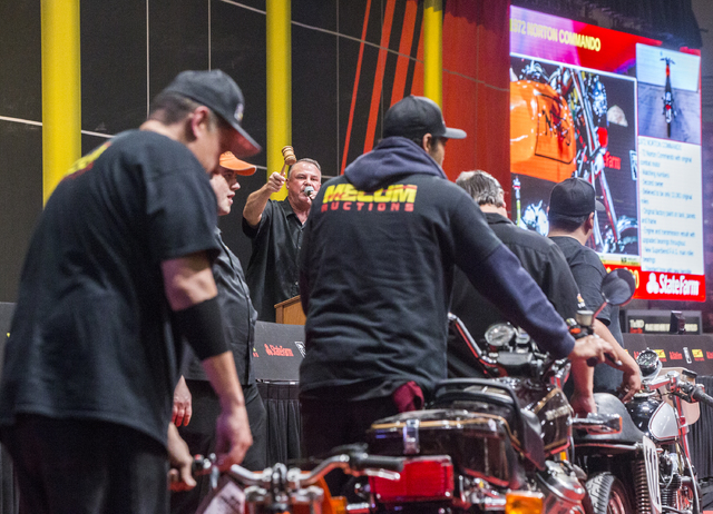 Auctioneer Don Wall calls for a bid during the 26th annual Mecum Las Vegas Motorcycle Auction at South Point hotel-casino, in Las Vegas. Over 1,000 antique, vintage and collectible motorcycles are ...