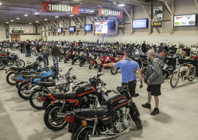 Edward Dolan, left, and Steve Shultz shop for bikes during the 26th annual Mecum Las Vegas Motorcycle Auction at South Point hotel-casino, in Las Vegas. Over 1,000 antique, vintage and collectible ...