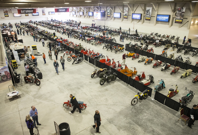 Bike enthusiasts pack one of the main showrooms at the 26th annual Mecum Las Vegas Motorcycle Auction at South Point hotel-casino, in Las Vegas. Over 1,000 antique, vintage and collectible motorcy ...