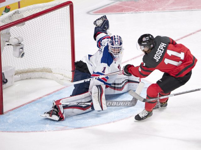 Canada's Mathieu Joseph (11) scores the fourth goal on United States' goaltender Tyler Parsons (1) during the third period of the gold medal hockey game at the World Junior ice hockey championship ...