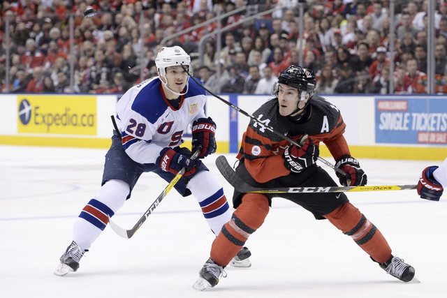 Canada forward Matt Barzal (14) keeps his eyes on the puck as U.S. forward Jack Roslovic (28) defends during the third period of a world junior championship hockey game in Toronto on Saturday, Dec ...