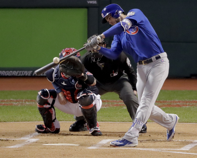 Chicago Cubs' Kris Bryant hits a single during the first inning of Game 2 of the Major League Baseball World Series against the Cleveland Indians Wednesday, Oct. 26, 2016, in Cleveland. (AP Photo/ ...