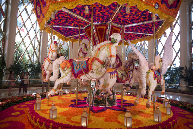 A carousel made with 103,000 flowers is displayed inside the Wynn Palace on Monday, Sept. 12, 2016, in Macau. (Erik Verduzco/Las Vegas Review-Journal) Follow @Erik_Verduzco