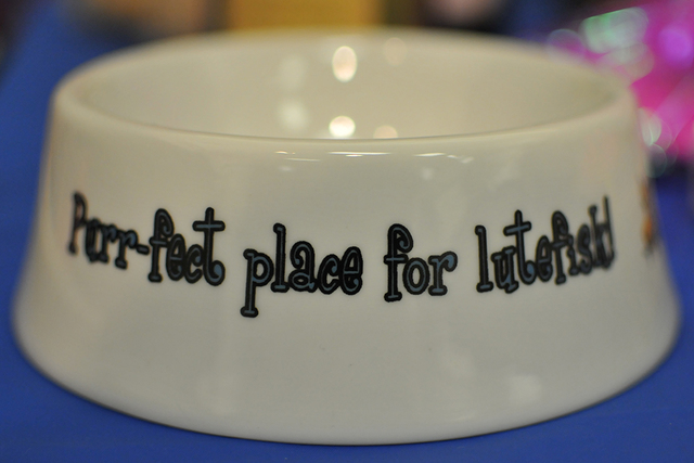 Lutefisk-themed pet-food bowls were among the many mementos sold at the dinner. BRIAN SANDFORD/VIEW FOLLOW @NWEDITOR