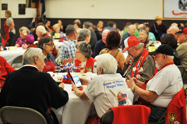 An attendee's Sons of Norway Vegas Viking T-shirt is seen in the foreground during the early lutefisk dinner Jan. 28 at Boulder City Elks Lodge. BRIAN SANDFORD/VIEW FOLLOW @NWEDITOR