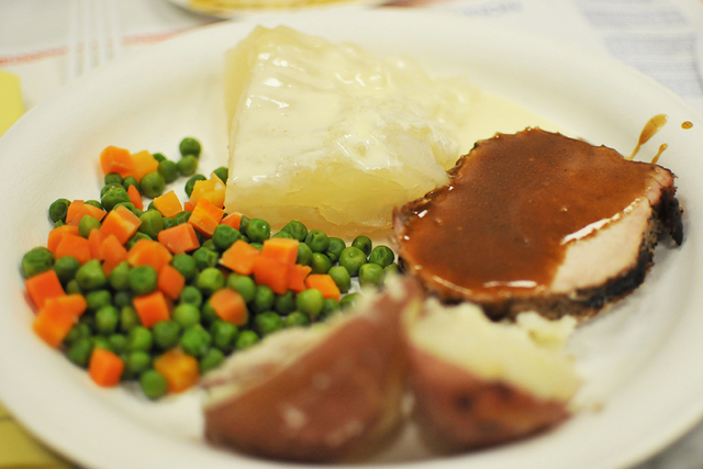Lutefisk, at the rear of the plate, was served with roasted pork, boiled potatoes and peas and carrots during the lutefisk dinner Jan. 28 at Boulder City Elks Lodge. Not pictured: lefse, a Norwegi ...