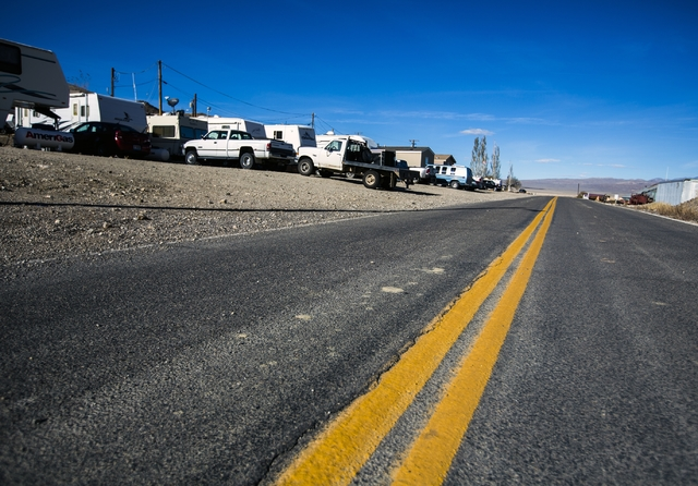 A trailers line State Route 256 at an RV park in Silver Peak, Nev. is seen on Friday, Nov. 21,2015. Many people working at the Rockwood Lithium mine have to commute to Tonopah  located 56 miles aw ...